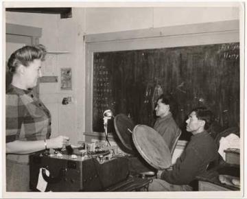 Laura Boulton with Joseph Sikvayugak and Otis Akhivigak recording in a one room schoolhouse in Barrow, Alaska, 1946