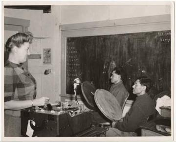 Laura Boulton with Joseph Sikvayugak and Otis Akhivigak recording in a one room schoolhouse in Barrow, Alaska, 1946