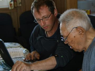 Aaron Fox working through Boulton recordings with the late Iñupiaq elder and music expert Warren Matumeak